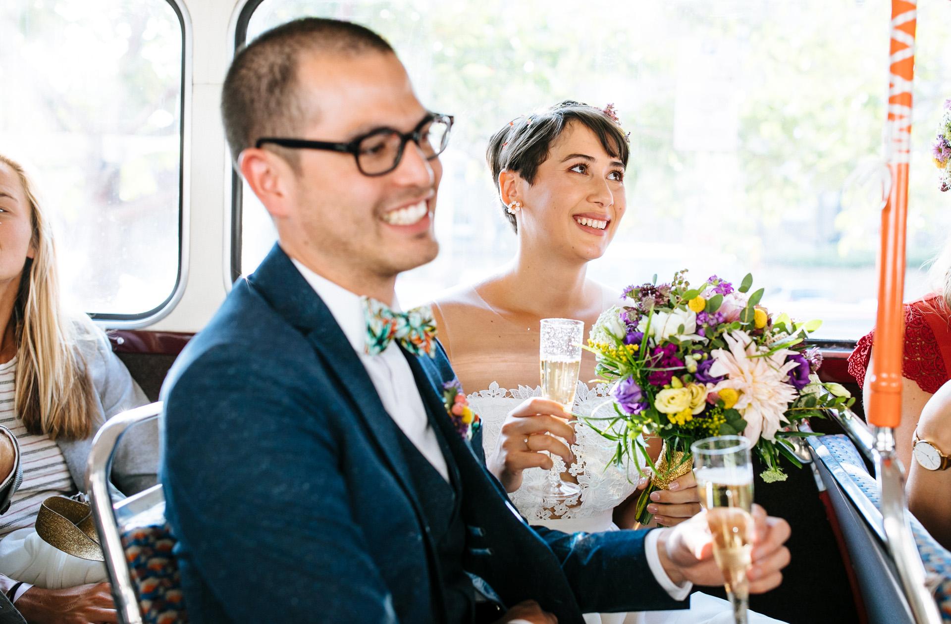 bride smiling on London routemaster wedding