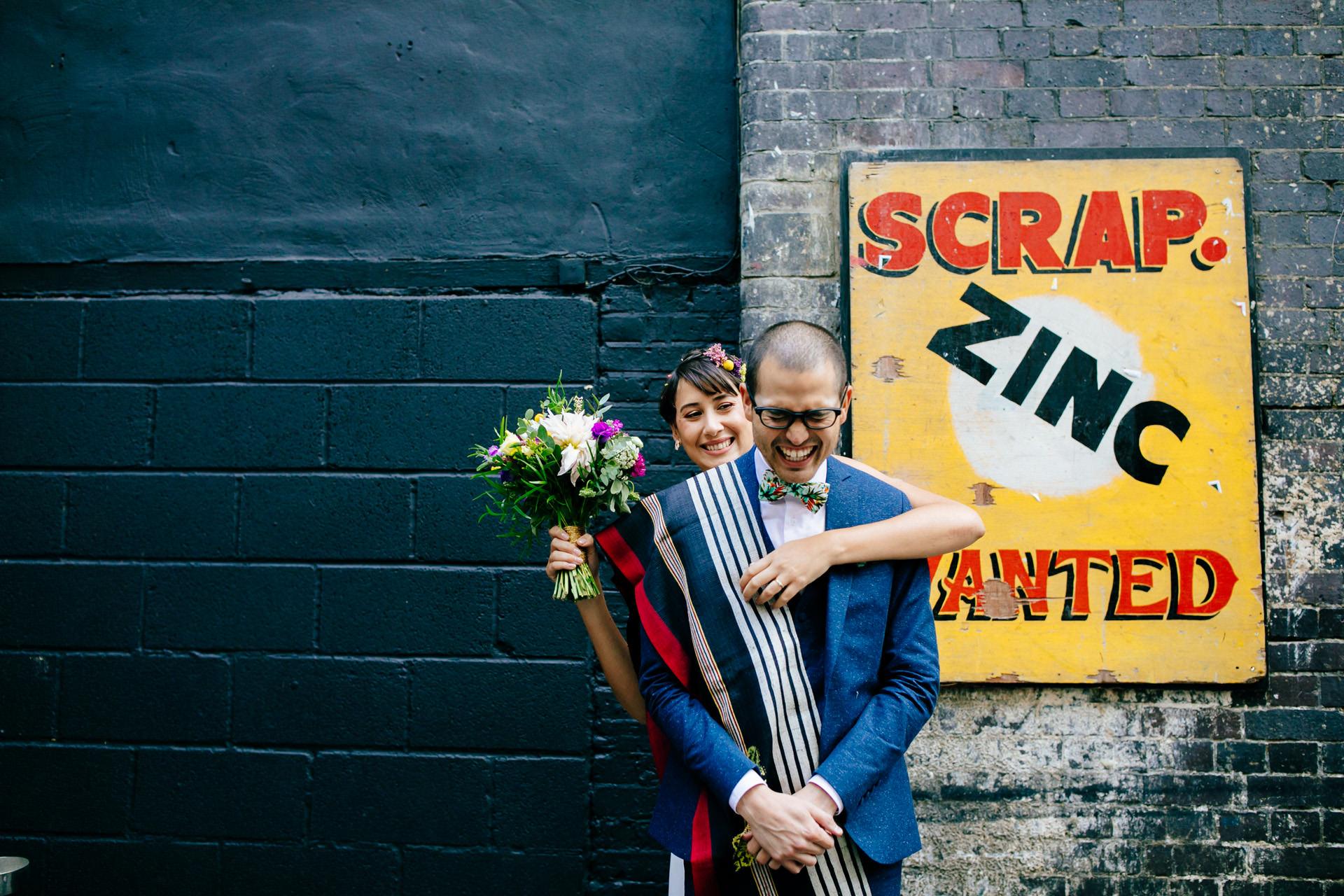 islington metal works wedding bride and groom hugging