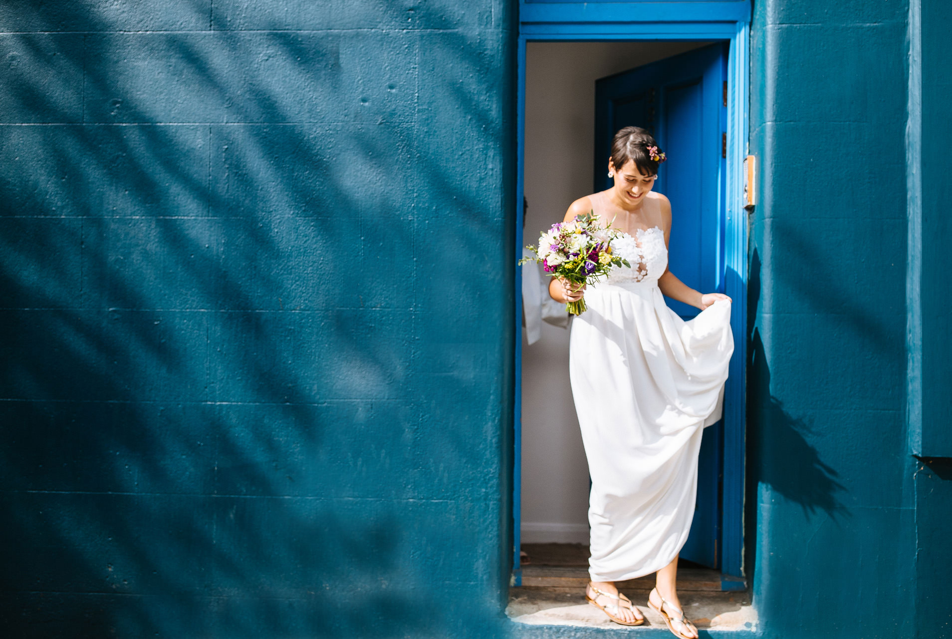 bride leaving her apartment on the wedding morning