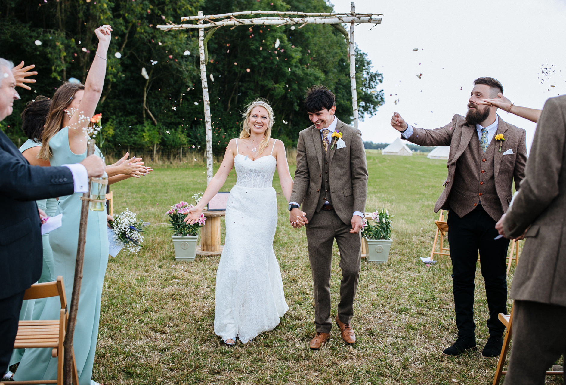 bride and groom embracing confetti at festival wedding in Kent