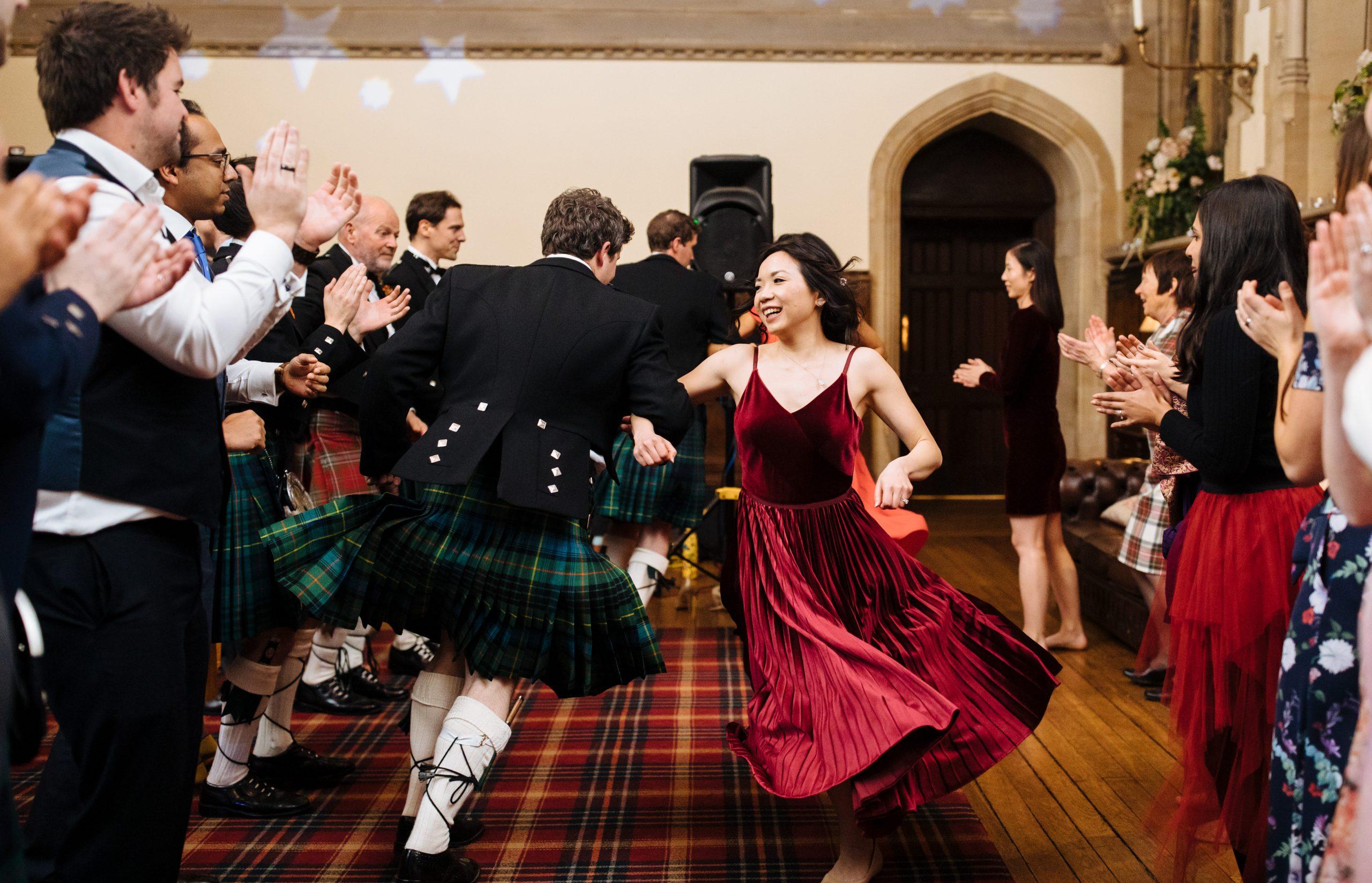 bride and groom ceilidh dance