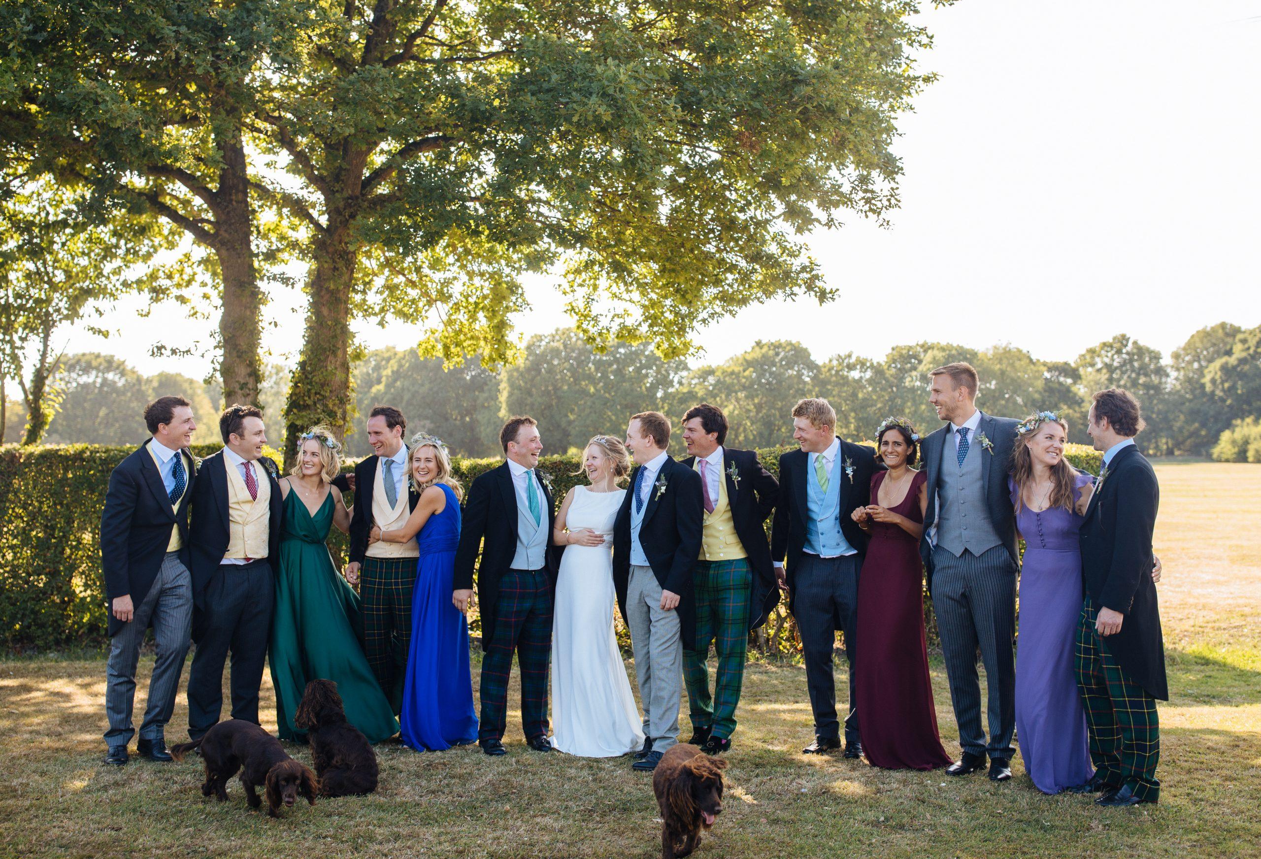 bridesmaids and groomsmen laughing at Kent wedding
