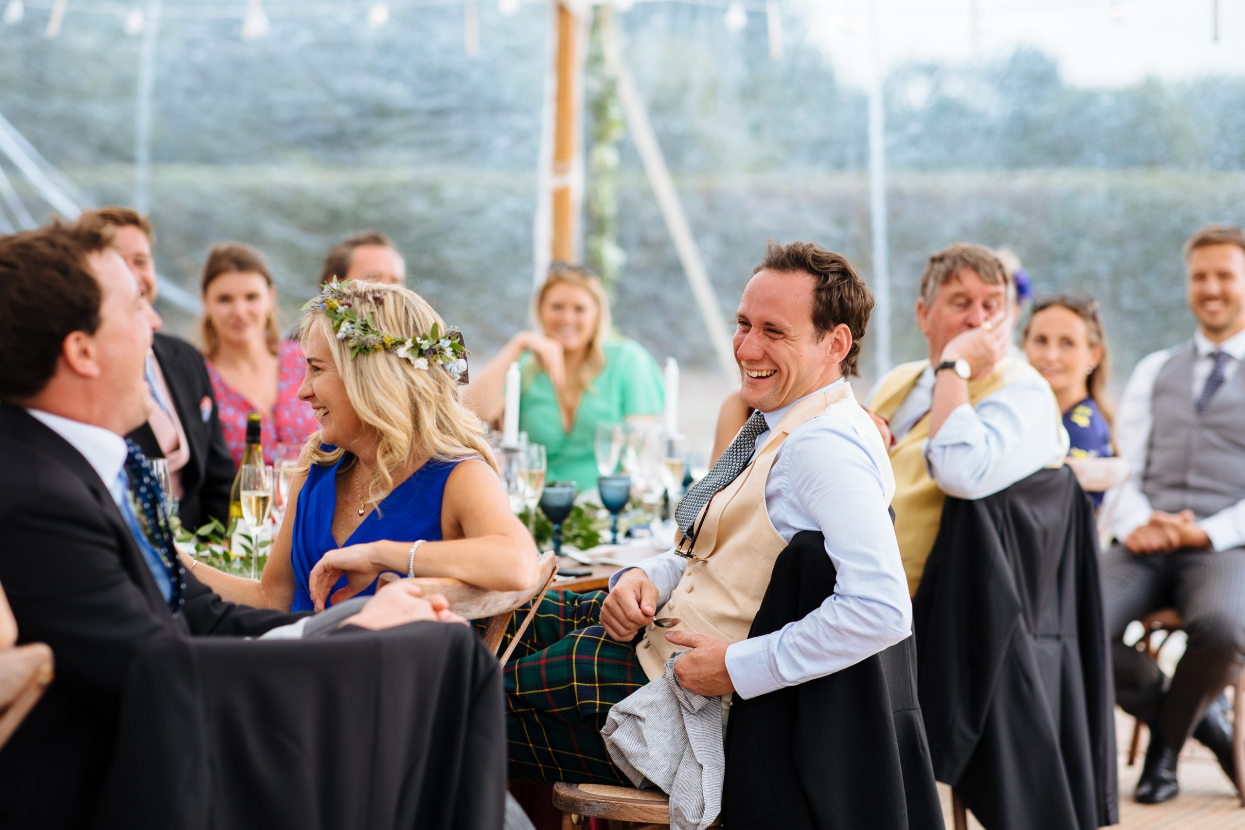 wedding guest laughing at speeches at Kent festival wedding