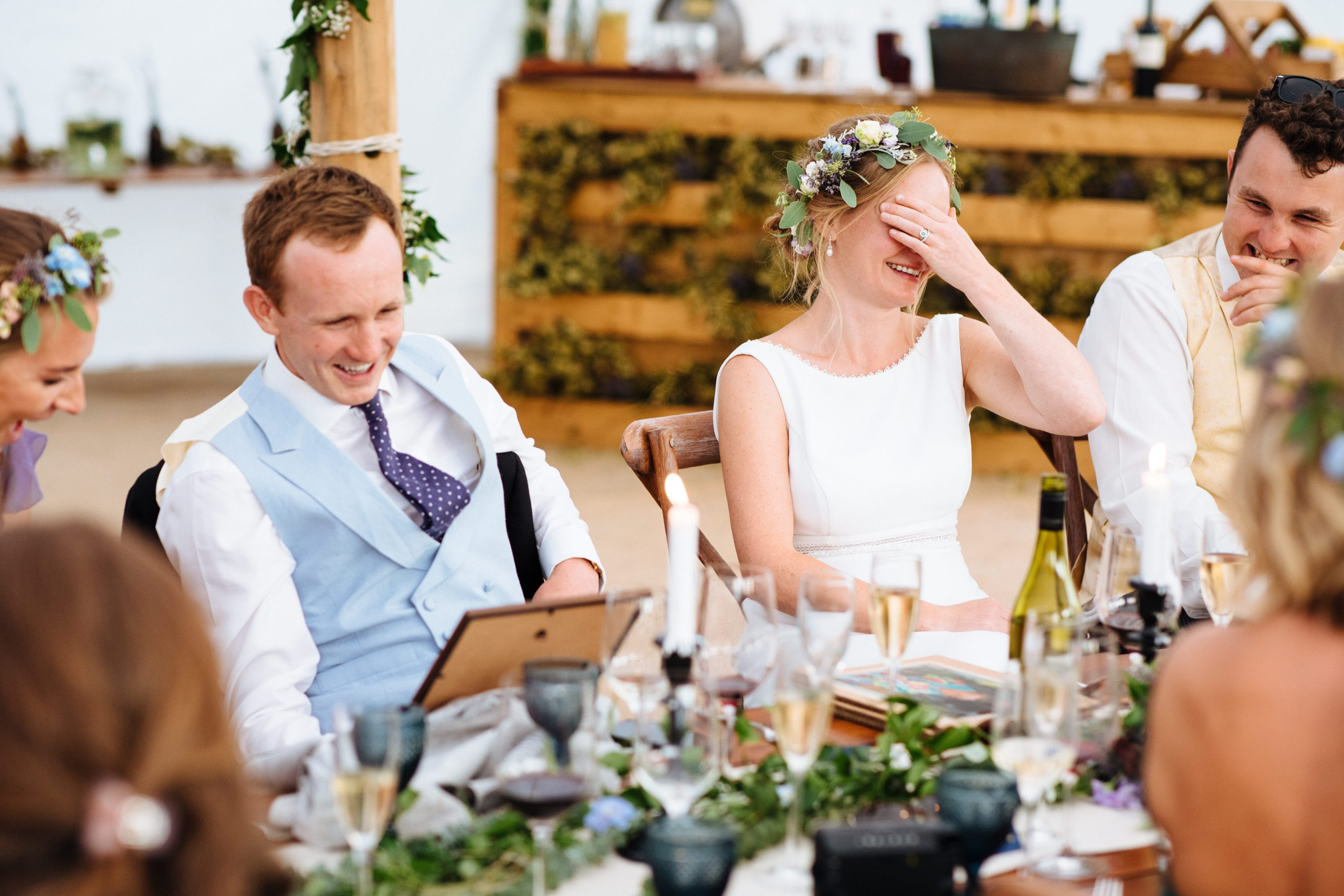 bride with flower crown embarrassed by best mans speech at rustic Kent wedding