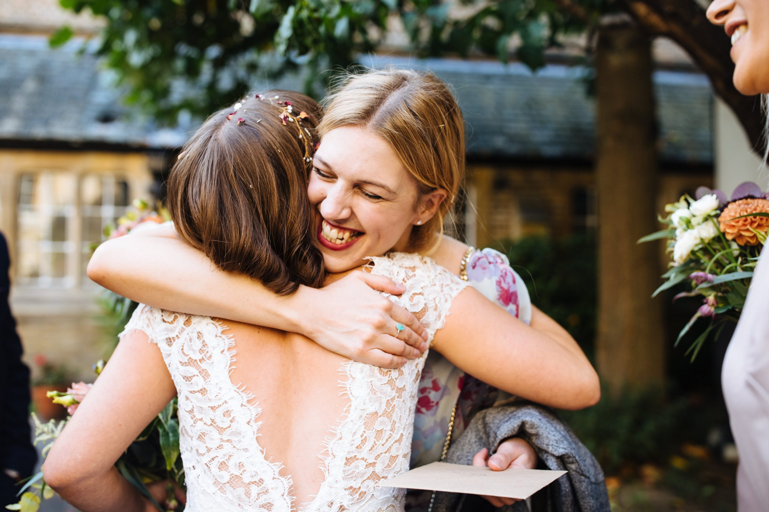 guest hugging bride smiling at le gothique wedding
