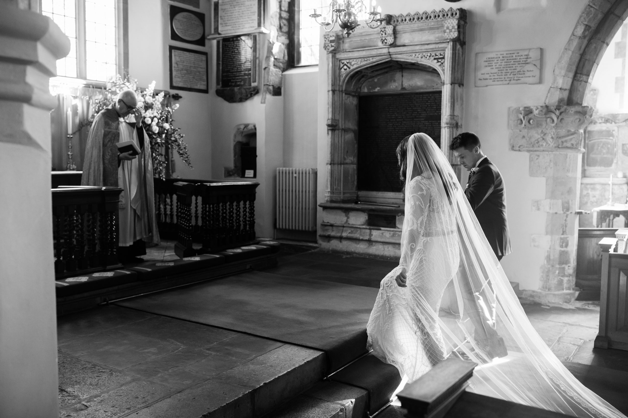 bride and groom in wedding ceremony at Chelsea old church