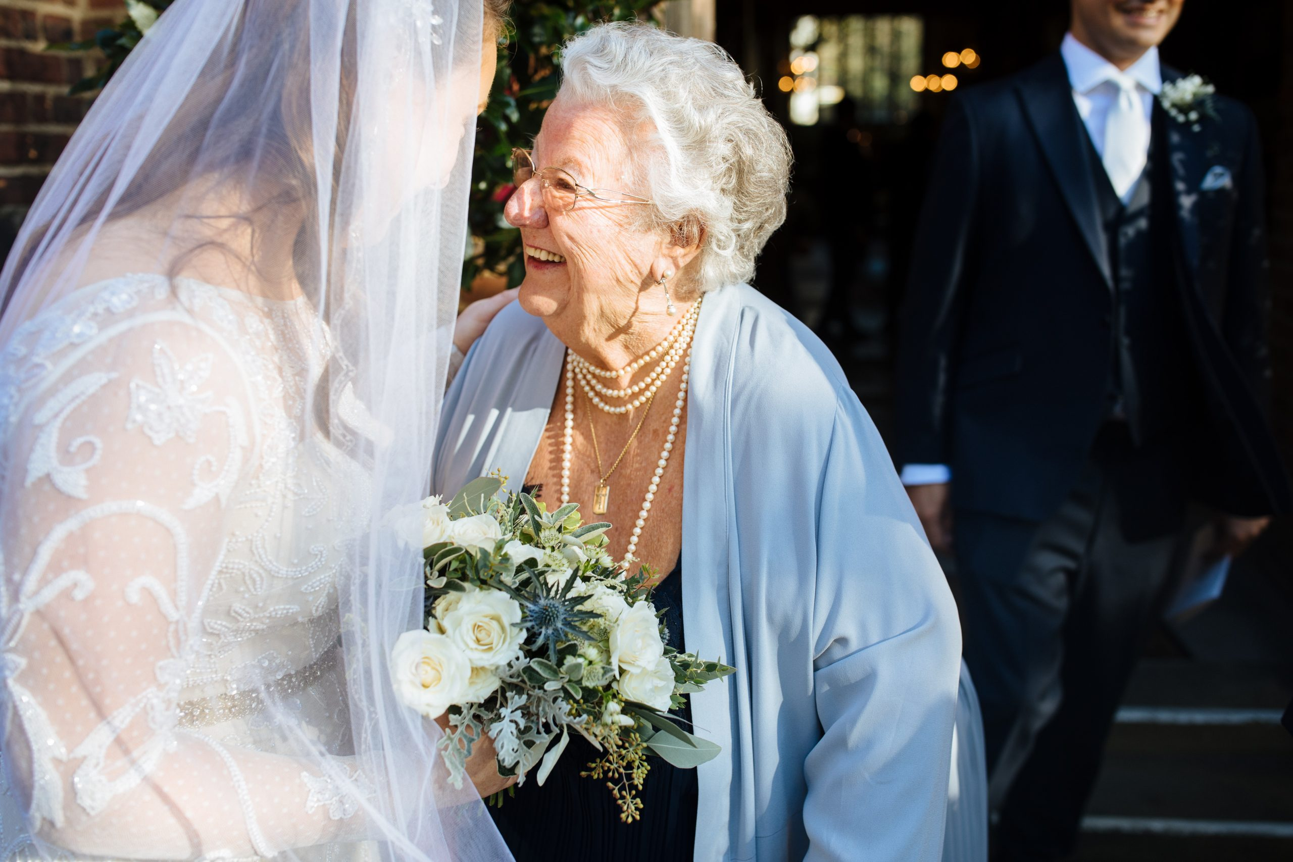 grooms gran laughing with bride after wedding ceremony