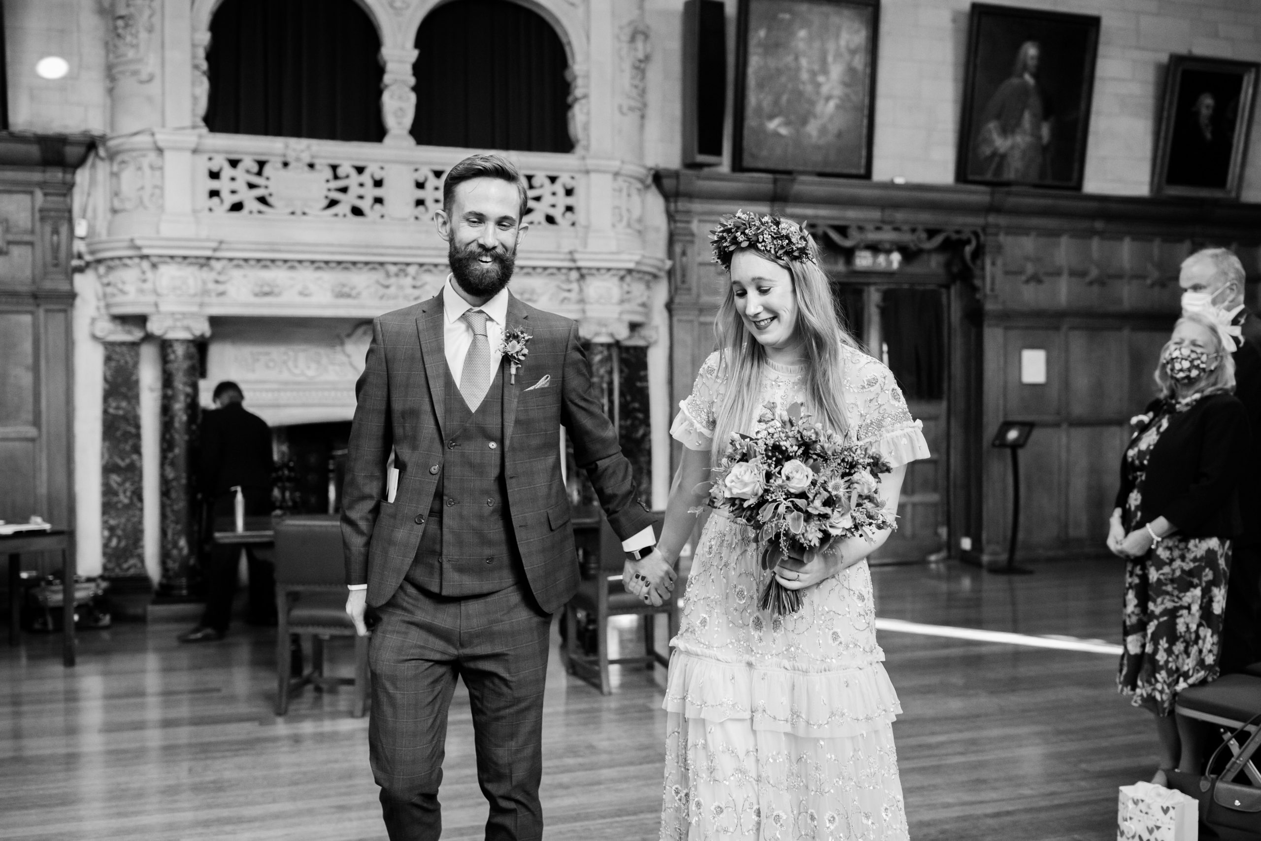 bride and groom leaving wedding ceremony at Oxford town hall