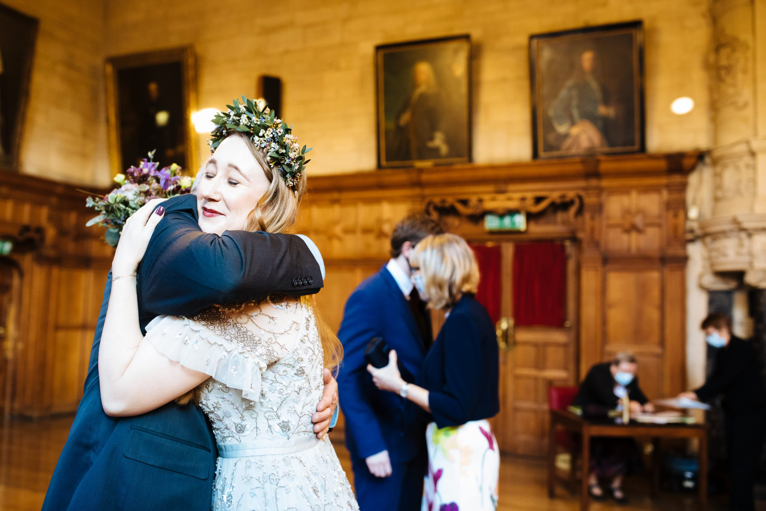 bride hugging dad after wedding ceremony at Oxford town hall