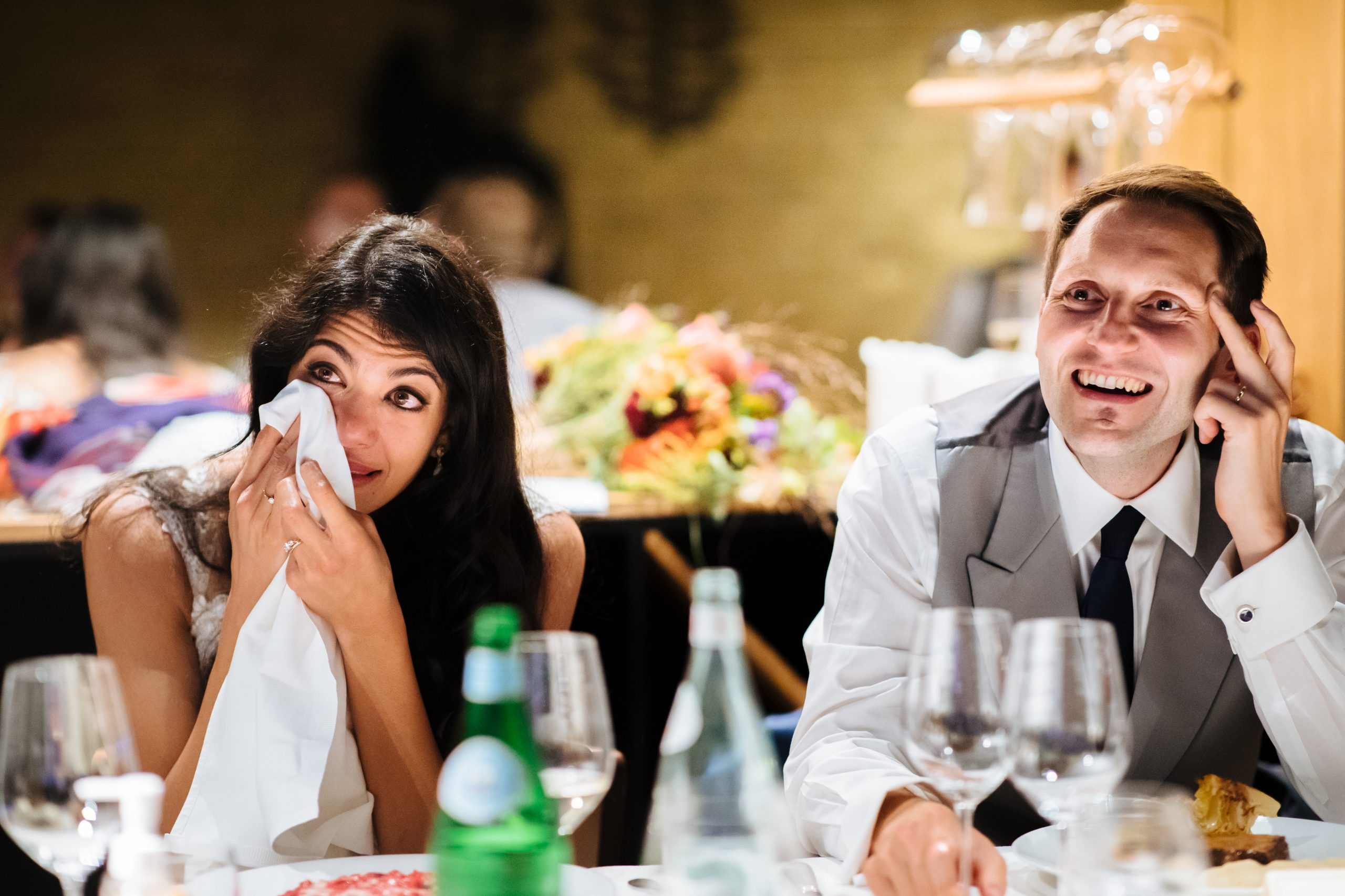bride crying at speeches dabbing eye with tissue