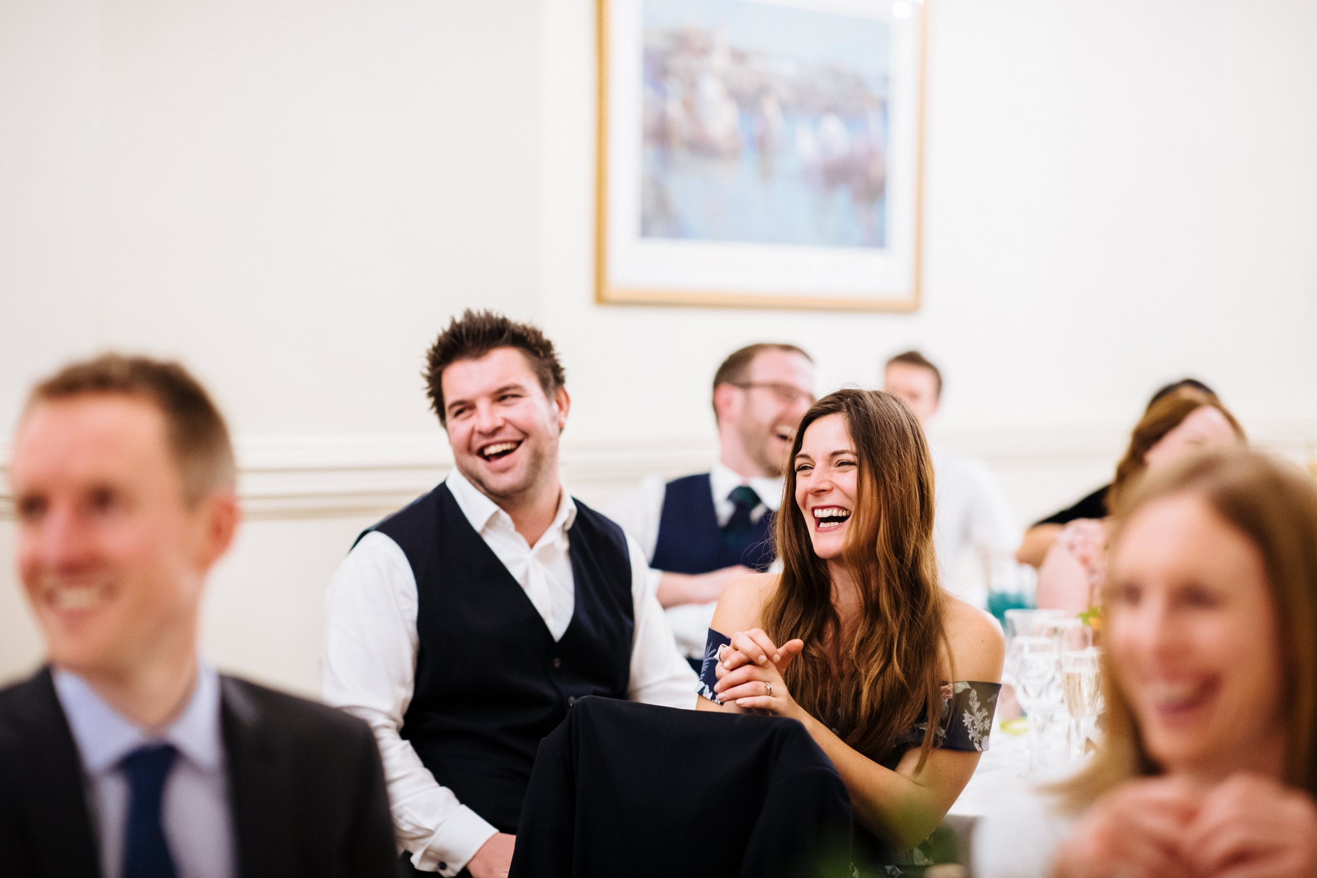 wedding guest laughing at speeches at st audries park wedding